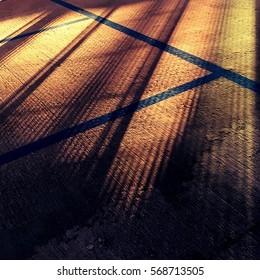 Shafts of light across car parking spaces