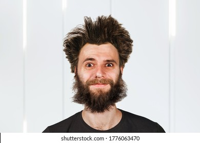 Shaggy young bearded man with long hair before haircut.