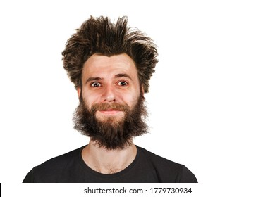 Shaggy young bearded man with long hair before haircut on a white isolated background.