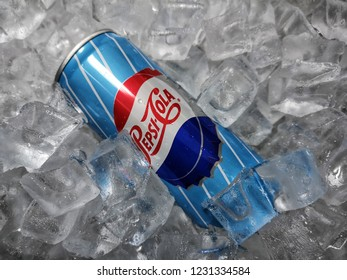 Shah Alam, Malaysia - 10 November 2018 : Can of PepsiCola on ice crushed. Pepsi is a carbonated soft drink that is produced and manufactured by PepsiCo. Created and developed in 1893.