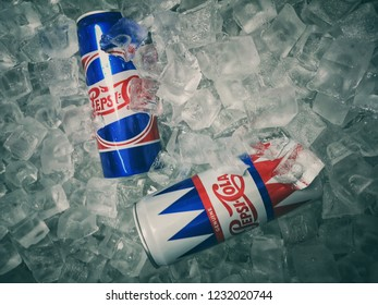 Shah Alam, Malaysia - 10 November 2018 : Two can's of PepsiCola Special Edition Retro on ice crushed. Pepsi is a carbonated soft drink that is produced and manufactured by PepsiCo. Selective focus.