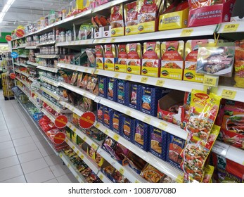Shah Alam , Malaysia - 13th January 2018 : Various types packet and bottle of spices for cooking ingredients display on shelves in a supermarket.