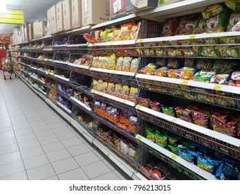 Shah Alam , Malaysia - 13th January 2018 : Grocery store shelf with various type assorted of junk foods packet in the supermarket.