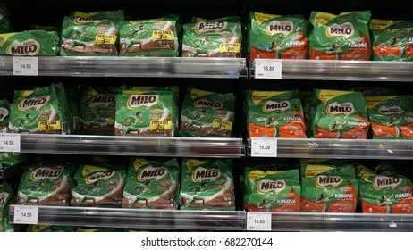 Shah Alam, Malaysia – 20 July 2017 :  Milo packed row on the shelf in the supermarket. Milo is a chocolate and malt powder produced by Nestle.
