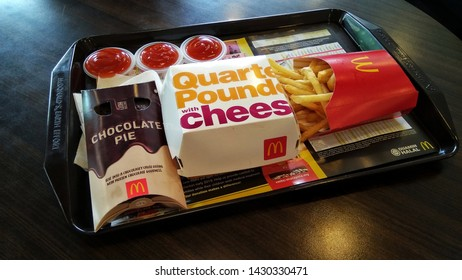 Shah Alam, Malaysia - 21 June 2019 : A famous McDonald's menu, Quater Pounder with Cheese, Chocolate Pie and a French Fries.