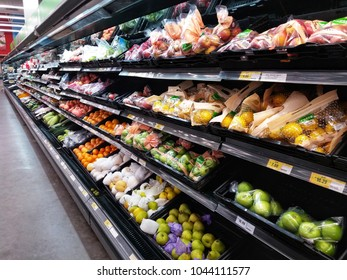 Shah Alam , Malaysia - 26 February 2018 : Packaging fresh fruits for sell display on the supermarket shelves.Mobile photoghpy.