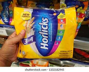 Shah Alam, Malaysia - 26 February 2019 : Hand hold a HORLICKS Cereal Drink Stick Pack for sell in the supermarket.