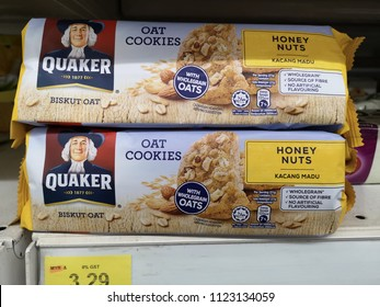 Shah Alam, Malaysia - 26 June 2018 : View a packet of QUAKER Oat Cookies with honey nuts display for sell in the supermarket shelves