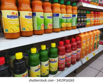 Shah Alam, Malaysia - 30 May 2019 : Assortment a Sunquick cordial bottle's displayed for sell on supermarket shelves with selective focus.Sunquick is a product of CO-RO A/S a Danish company.