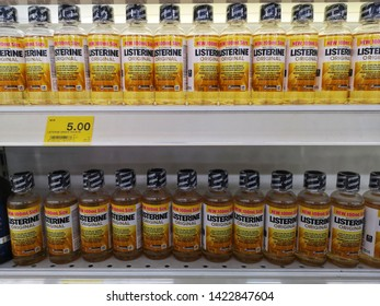 Shah Alam, Malaysia - 30 May 2019 : Row of LISTERINE Original liquid bottle's display for sell in the supermarket shelves with selective focus.