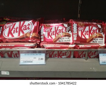 Shah Alam , Malaysia - 7 March 2018 : Product of Nestle, Kit Kat wafer fingers in milk chocolate on display for sale in supermarket.