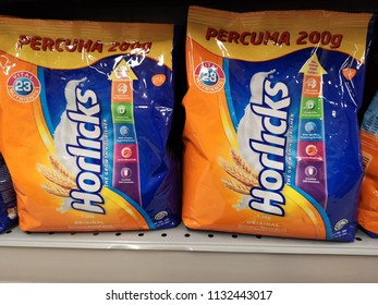 Shah Alam, Malaysia - 9 July 2018 : Close up a packets of HORLICKS Nutritious Malted Drink display for sell in the supermarket shelf.