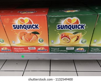 Shah Alam, Malaysia - 9 July 2018 : Two different box of SUNQUICK bottle's fruit juices flavour Mandarin and Tropical display for sell in the supermarket shelf.