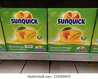 Shah Alam, Malaysia - 9 July 2018 : View a box of SUNQUICK bottle's fruit juices flavour mixed mango display for sell in the supermarket shelf.
