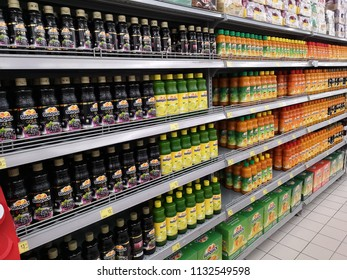 Shah Alam, Malaysia - 9 July 2018 : Assorted of SUNQUICK bottle's fruit juices flavour in the supermarket shelf.