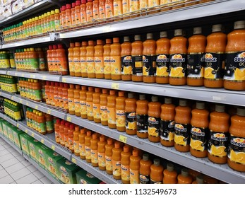 Shah Alam, Malaysia - 9 July 2018 : Colorful of SUNQUICK bottle's fruit juices flavour neatly arranged for sell in a supermarket shelf.
