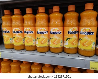 Shah Alam, Malaysia - 9 July 2018 : Line of SUNQUICK bottle's fruit juices flavor orange display for sell in the supermarket shelf. Mobile photoghpy.