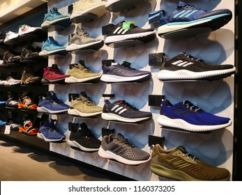 SHAH ALAM, MALAYSIA - AUGUST, 2018: Adidas shoes in shoe store display. It is a German multinational corporation that designs and manufactures sports clothing and accessories based in Germany.