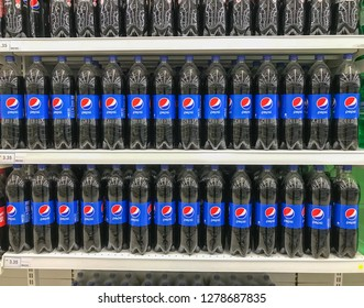 Shah Alam, Malaysia - January 06, 2018; Pepsi drinks in the bottle on supermarket shelf. Pepsi is a carbonated soft drink that is produced and manufactured by PepsiCo.