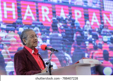 SHAH ALAM, MALAYSIA - JANUARY 07, 2018. Former Prime Minister of Malaysia, Mahathir Mohamad deliver his speech during the Pakatan Harapan meeting in Shah Alam. Low light and high ISO photography.