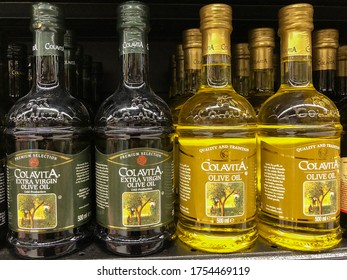 SHAH ALAM, MALAYSIA - JUNE 4, 2020: Cooking olive oil in bottles from olive tree brand 'Colavita' in the supermarket shelf for sales.