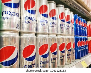 Shah Alam Malaysia March 1 2017 : Rows of shelf at Village Grocer Hypermarket with Pepsi Light canned drinks on display in a grocery store. Pepsico is leading manufacturer of soda drinks in the world