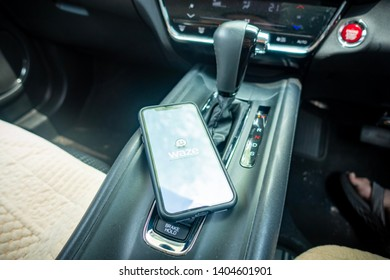 Shah Alam, Malaysia - May 2019. A man holding the iPhone 7 X with Waze navigation app inside the car. Waze has gain popularity for its good navigation.