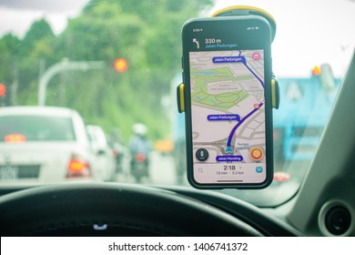 Shah Alam, Malaysia - May 2019. An iPhone X with Waze navigation app inside the car. Waze has gain popularity for its good navigation.