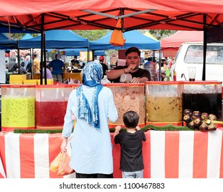 SHAH ALAM, MALAYSIA - MAY 27, 2018: Customers at a refreshment stall in a Ramadan food bazaar in Shah Alam. The food bazaar is established for Muslim to break fast during the holy month of Ramadan.