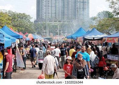 SHAH ALAM, MALAYSIA - MAY 27, 2018: Shoppers at a Ramadan food bazaar in Shah Alam, Malaysia. The food bazaar is established for Muslim to break fast during the holy month of Ramadan.