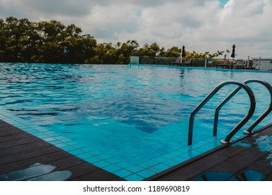 Shah Alam, Malaysia - September 2018: Alami Residence swimming pool in the evening.