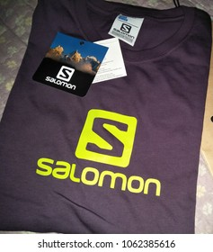 Shah Alam , Selangor , Malaysia - 5 April 2018 : Salomon running shirt brand with hang tag is displayed for sale in the shop shelf. Salomon is a sports equipment. View from right angle.