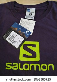 Shah Alam , Selangor , Malaysia - 5 April 2018 : Close up of Salomon running shirt brand with hang tag is displayed for sale in the shop shelf. Salomon is a sports equipment. View from right angle.