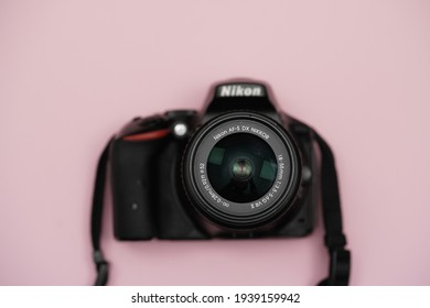 Shah Alam Selangor, Malaysia - March 19, 2021 : Selective focus of nikkor kitlens mount on nikon d5500 body with pink background.