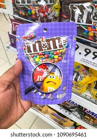 Shah Alam, Selangor, Malaysia- May 09, 2018; Hand hold a M&M chocolate candies mint packet in the supermarket.