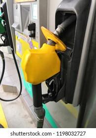 Shah Alam, Selangor, Malaysia - October 2018 :Closeup yellow nozzle for Petronas Primax 95 at Petronas petrol station. Petronas is a Malaysian oil and gas company.