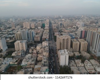 shaheed e millat road karachi  on of the main roads in karachi filled wit buildings