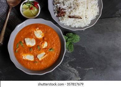 Shahi paneer / Butter Paneer with cumin rice, overhead view
