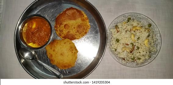 Shahi paneer &  Puri or poori with steamed rice. Indian gujarati food puri or poori. Homemade Indian Potato Poori or Puri served with Shahi paneer & Steamed rice.