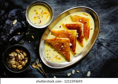Shahi Tukda tukra  or double ka meetha  - Diwali sweetmade of bread dipped in sugar syrup and Rabri