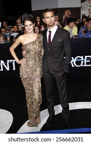 """Shailene Woodley and Theo James at the Los Angeles premiere of """"Divergent"""" held at the Regency Bruin Theatre in Westwood on March 18, 2014 in Los Angeles, California."""