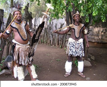 SHAKALAND, SOUTH AFRICA - CIRCA NOVEMBER 2011: Unidentified Zulu men wearing traditional Zulu warrior clothing at Shakaland Zulu Cultural Village, KwaZulu-Natal, South Africa