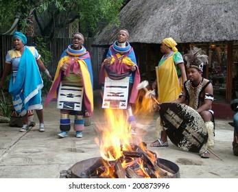 SHAKALAND, SOUTH AFRICA - CIRCA NOVEMBER 2011: Unidentified Zulu dancers wear traditional Zulu clothing, during presentation of a Zulu show Shakaland Zulu Cultural Village, KwaZulu-Natal, South Africa