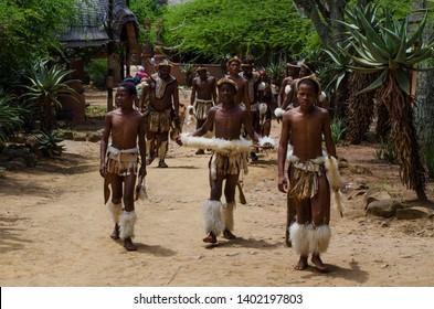 Shakaland Zulu Cultural Village, KwaZulu-Natal, South Africa - December 2016: Yong aborigenes in traditional Zulu wear