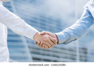Shake hands Make good cooperation and reach a business agreement.