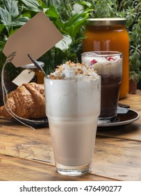 Shake (smoothie) with bread on rustic wooden table
