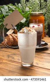 Shake (smoothie) with croissant on rustic wooden table