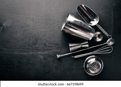 Shaker, measuring glass, bar spoon. Top view. Free space.