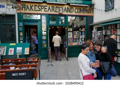 Shakespeare and Company bookstore, Paris France, September 28, 2016: Three female tourists taking a selfie in front of the famous bookstore.
