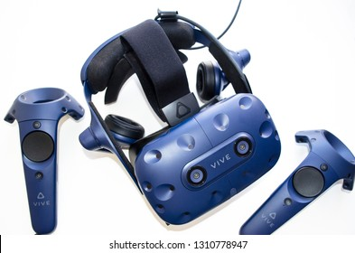 SHAKHTERSK, RUSSIA - FEBRUARY 6, 2019: A closeup of a the  controllers and virtual reality headset HTC VIVE PRO on a white background.